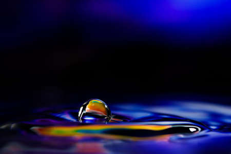 surface tension: Macro photography of colorful abstract water drop creations.
