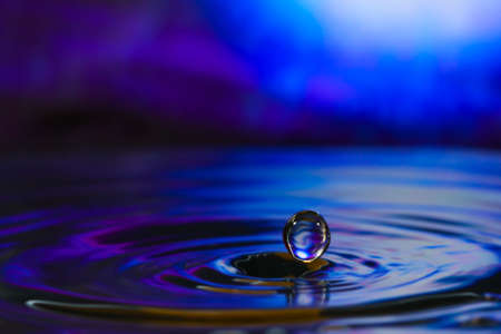 Macro photography of colorful abstract water drop creations.
