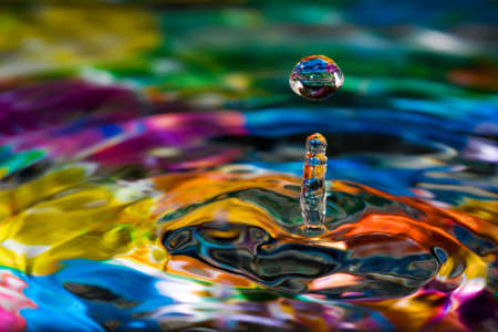 on the surface: Macro of colorful abstract water drop creations. Stock Photo