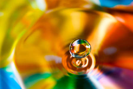 surface tension: Macro of colorful abstract water drop creations. Stock Photo