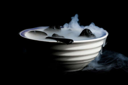 A Smoking bowl of lava rocks and spoon.