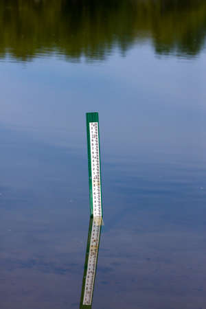 depth measurement: Water level measurement gauge. Stock Photo