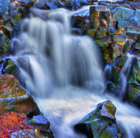 Colorful scenic river waterfall in HDR and slow shutter.