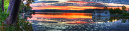 Panorama of a sunrise and pump house utility on a lake. Stock Photo - 9165133