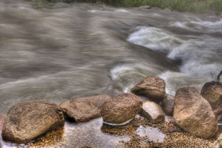 unsettled: Unsettled fast flower river rapids in HDR. Stock Photo