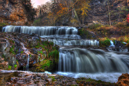 Colorful scenic waterfall in High Dynamic Range. Stock Photo