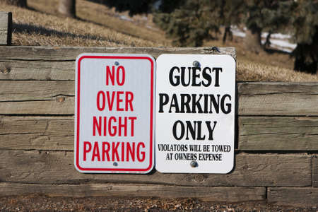 dissuade: Guest Parking only and no overnight parking Sign.