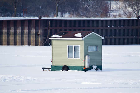 Fish house on a frozen lake during winter  photo