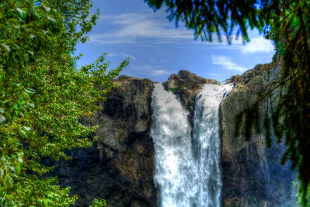 Water going over the falls at a national forest in HDR
