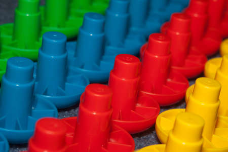 lined up: Rows of colorful childrens blocks lined up. Stock Photo