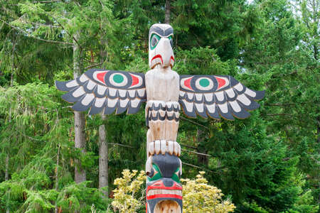 historic totem pole by ancient native indian americans photo
