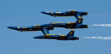 supersonic: Mankato, Mn- June 9 US Navy Blue Angels in F-18. Hornet planes perform in air show routine in Mankato, MN on June 9th 2012. Blue Angels are the oldest active aerobatic team in the world