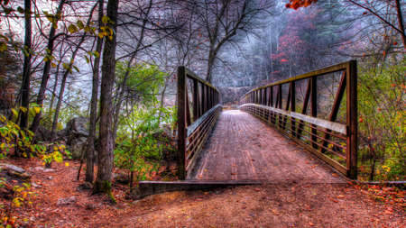 high dynamic range: Creek and Bridge in HDR. Fall colors in soft focus