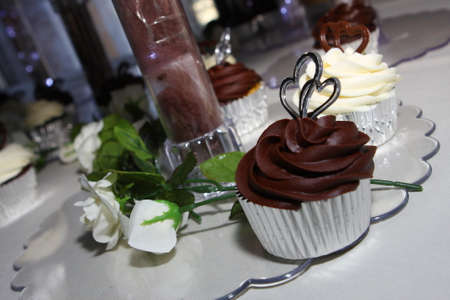 Wedding cake of cupcakes chocolateand vanilla photo