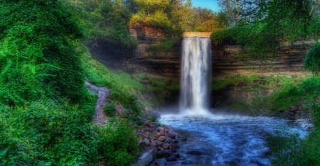downstream: Beautiful Minnehaha Creek Waterfall and downstream river in HDR High Dynamic Range.