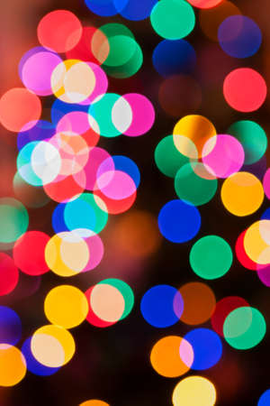 bash: Glowing Christmas lights background in abstract image in soft focus.