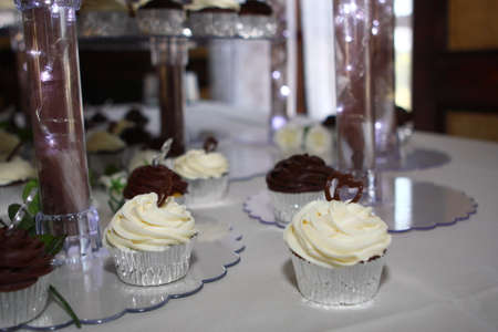 Wedding Cupcakes of chocolate with frosting and hearts photo