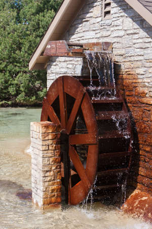 grist mill: Water Wheel in motion with lots of rust Stock Photo
