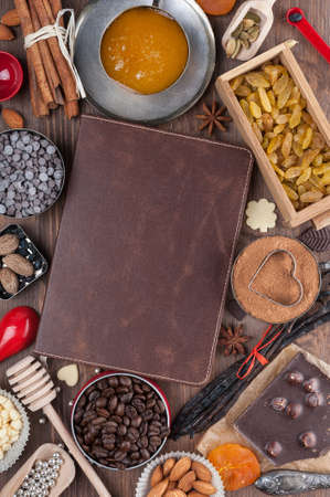 Cover of the book to write prescriptions surrounded ingredients for a sweet holiday baking Stock Photo
