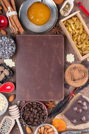 Cover of the book to write prescriptions surrounded ingredients for a sweet holiday baking photo