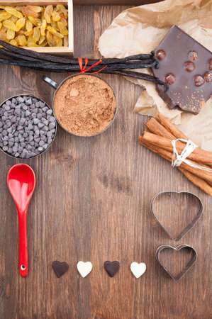 Ingredients for baking chocolate on a dark wooden background Stock Photo