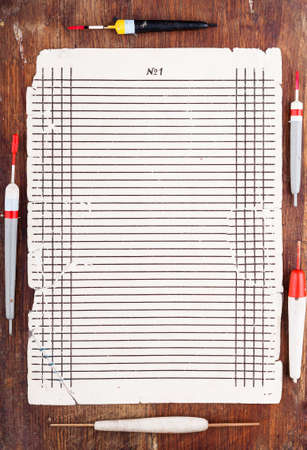 Sheet to record the results of fishing floats surrounded Stock Photo - 18376633