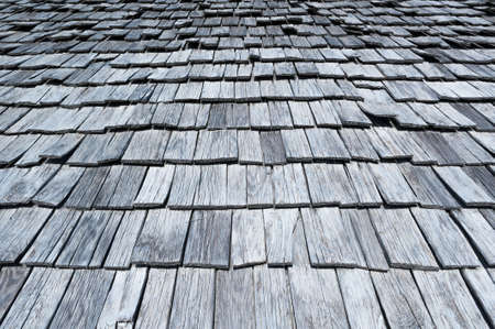 Typical wooden shingles on old houses in Switzerland Stock Photo
