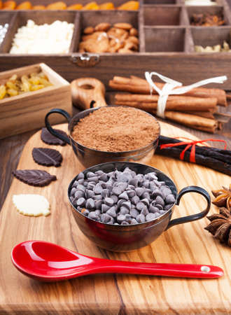 Ingredients for baking chocolate on a dark wooden