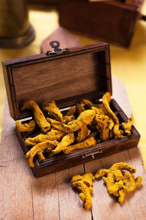 Rhizome of turmeric in a wooden box