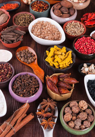 Large set of spices, seasonings and salt photo