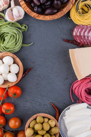 Typical Italian products on black board Stock Photo