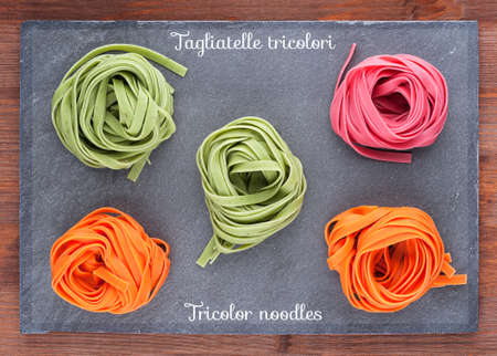 Tricolor Italian homemade noodles on a slate board