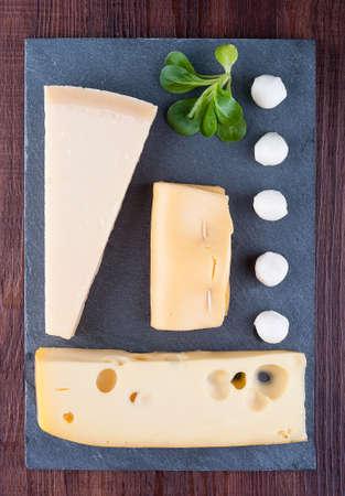 Set of various cheese on a slate blackboard