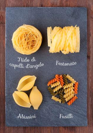 Set of traditional Italian pasta on a slate blackboard photo
