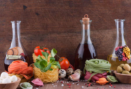 Set of typical italian food on a wooden background