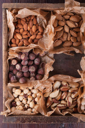 Set of nuts in a wooden box and wrapping paper