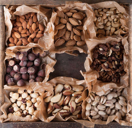 Collection of nuts in a wooden box. Top view.