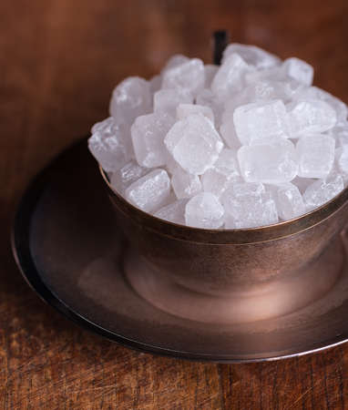 White sugar candies in a coffee cup