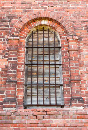 Window in an old brick church background