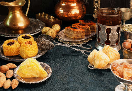 Large set of Eastern, Arab, Turkish sweets with copy space Stock Photo