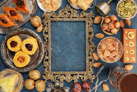 baklawa: Large set of Eastern, Arab, Turkish sweets with frame top view copy space Stock Photo