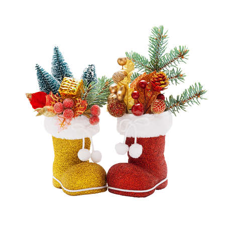 Red and golden boots of Santa Claus with Christmas decorations isolated