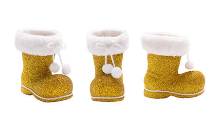 Set of empty golden boots of Santa Claus isolated Stock Photo