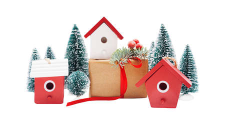 Christmas linear arrangement of birdhouses, trees and gift boxes isolated on white