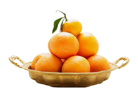 Oranges on a round platter isolated
