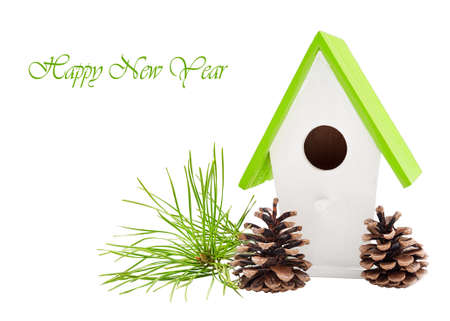 Christmas composition with bird house with pine branches and cones isolated Stock Photo
