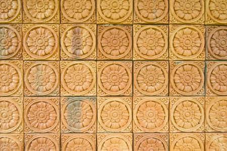 Beautiful brick wall with flower pattern photo