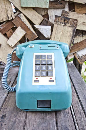 conventional: Blue Vintage telephone on old wood table