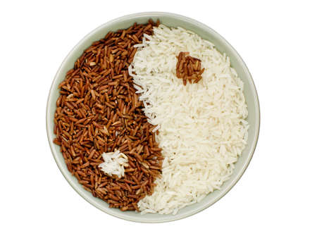 Black and white rice forming a yin yang symbol photo