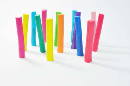 Colorful plasticine stick stand on white background Stock Photo - 14567443